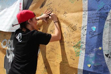Signing the wall at Pulse Nightclub